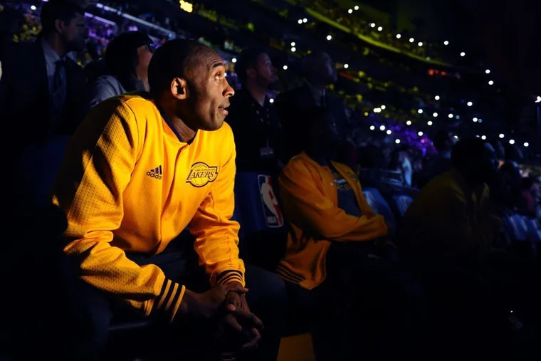 The late Kobe Bryant, shown watching a tribute video at Staples Center before the final game of his career on April 13, 2016.