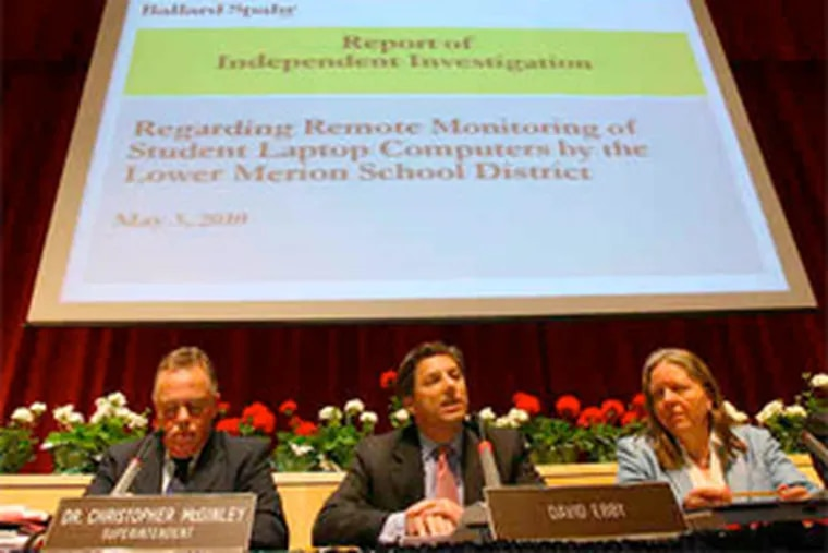 School board member David Ebby (center) at a meeting where Henry E. Hockeimer Jr., a former prosecutor hired by the board, released a report critical of the district's use of Web cams that took thousands of photos of students. (Charles Fox / Staff Photographer)