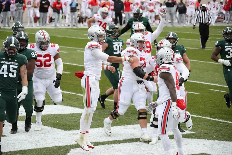 Ohio State quarterback Justin Fields (center) celebrates a touchdown against Michigan State.