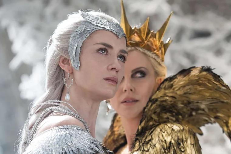 """Emily Blunt is Freya, Her Frosty Majesty, and Charlize Theron (right) is Ravenna, her evil sister, in """"The Huntsman: Winter's War."""""""