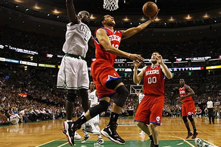 Evan Turner goes up for two against the Celtics' Kevin Garnett in the second quarter of Game 1. (Ron Cortes/Staff Photographer)