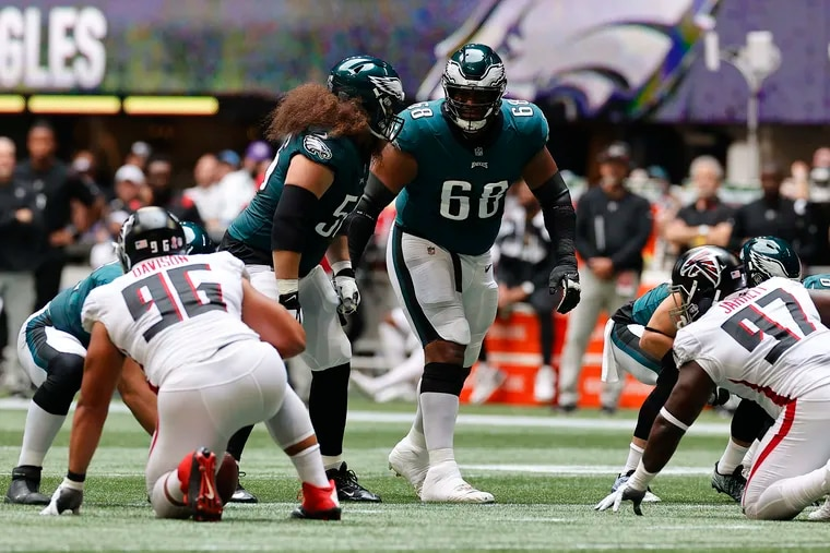 Eagles offensive tackle Jordan Mailata looks at guard Isaac Seumalo during the team's 32-6 victory over the Falcons.