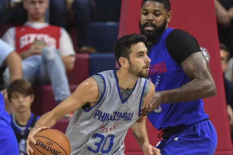 Philadelphia 76ers rookie Furkan Korkmaz works against Amir Johnson during a scrimmage earlier this year at the Palestra.
