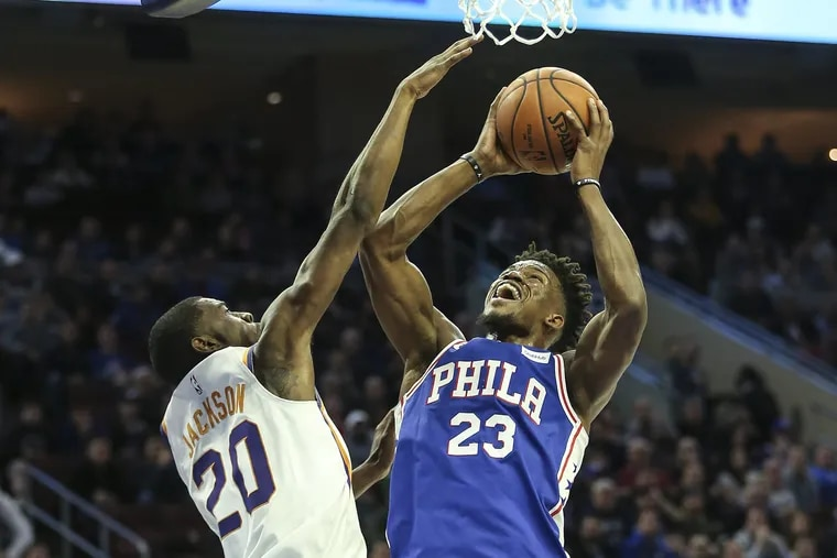 Jimmy Butler puts up a shot past the Suns' Josh Jackson during the Sixers win on Monday.