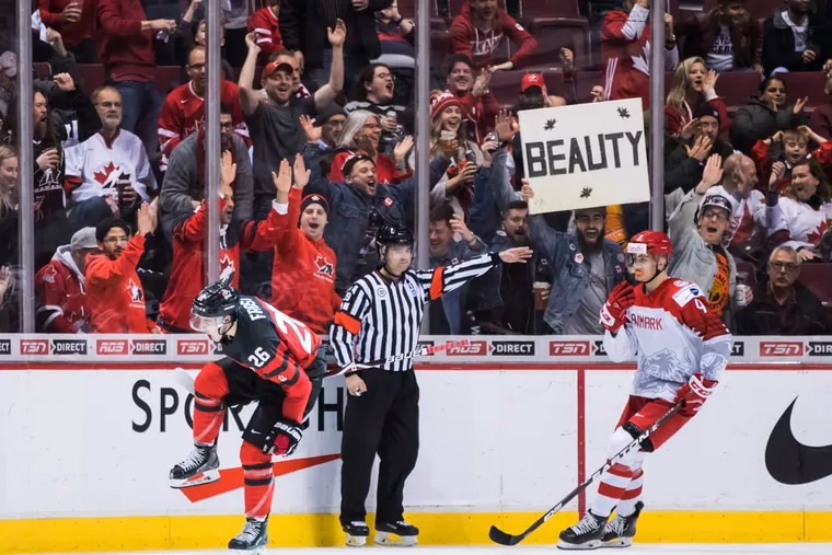 Morgan Frost (left) celebrates his third goal during Canada's blowout of Denmark on Wednesday at the World Junior Championship.