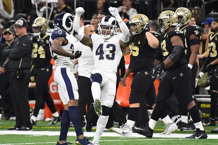 Rams safety John Johnson III (43) celebrates his interception against the Saints in overtime in the NFC championship game.