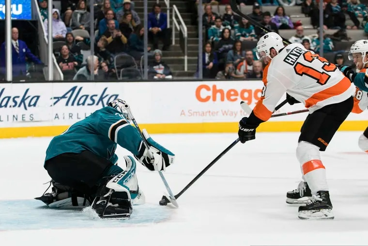 Then-San Jose Sharks goaltender Martin Jones stopping the Flyers' Kevin Hayes during a game early in the 2019-20 season. The Flyers signed Jones in late July.