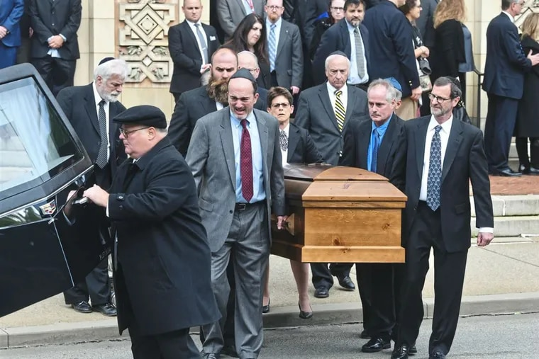 Pallbearers carry the caskets of Cecil and David Rosenthal following the funeral at Rodef Shalom Congregation on Tuesday, Oct. 20, 2018, in Shadyside.