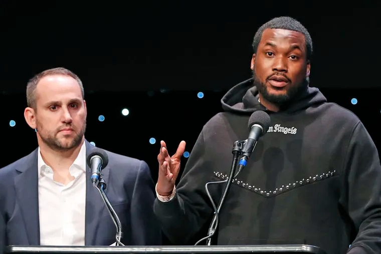 Recording artist Meek Mill (right) speaks about his incarceration along with Philadelphia 76ers co-owner and Fanatics executive chairman Michael Rubin at the launch of Reform Alliance, a partnership among entertainment moguls, entrepreneurs, recording artists, and business and sports leaders who hope to transform the American criminal justice system.