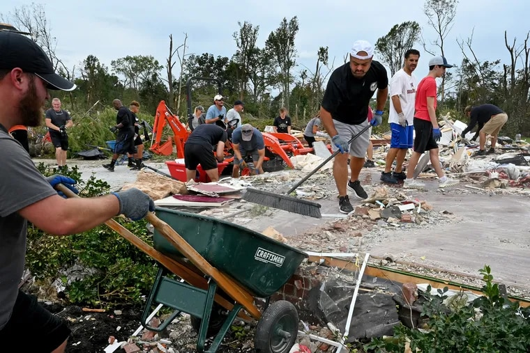 Anthony Dagrosa sweeps up what's left of his flattened home on Salvatore Drive in Mullica Hill on Sunday. His neighbors and volunteers helped him clean up following the destruction from a tornado spawned by the remnants of Hurricane Ida.
