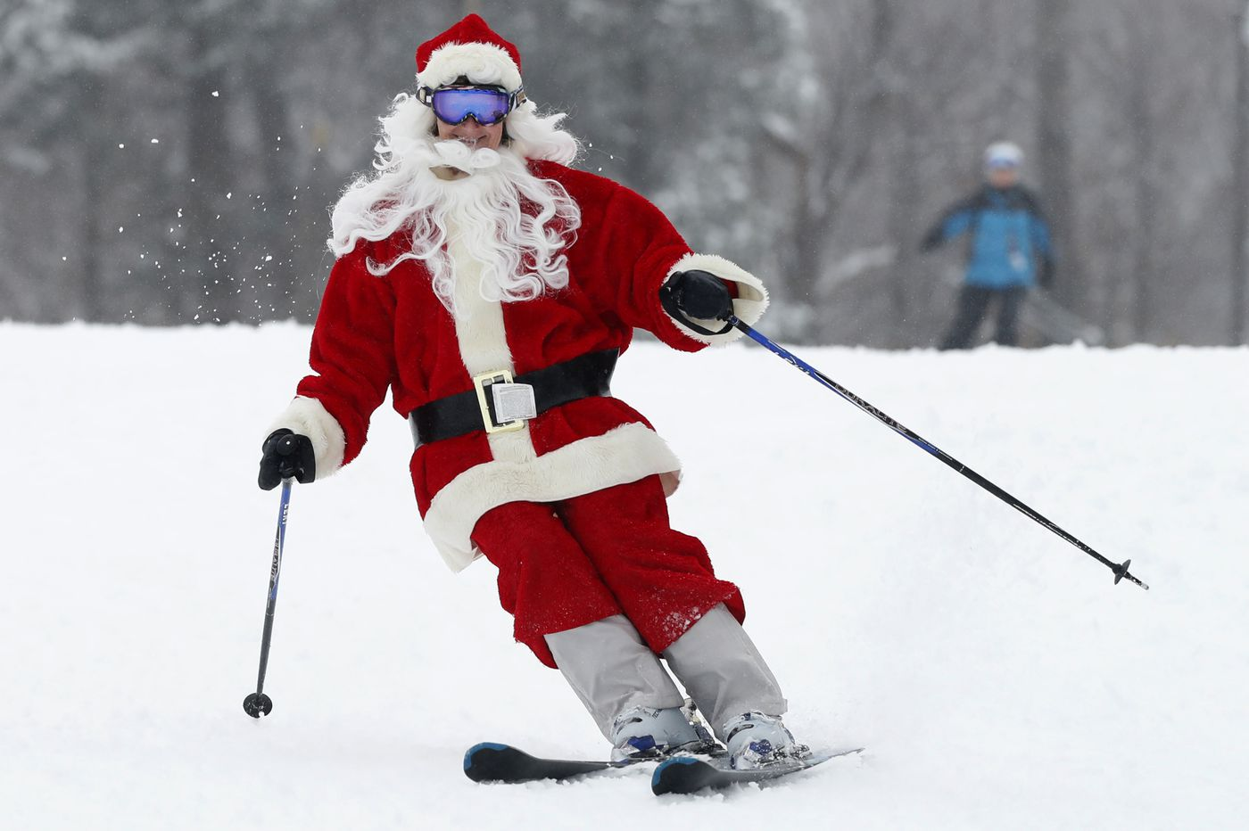 Hundreds of skiing Santas hit the slopes for a good cause