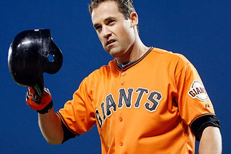 Pat Burrell will be back in Philadelphia to face the Phillies in the National League Championship Series. (Ben Margot/AP)