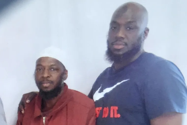 Mustafa Thomas, left, with his brother Shaurn, right. The Philadelphia DA'S Office in May 2018 dropped its prosecution of Mustafa Thomas for a 1990 murder, two years after charges were dropped against Shaurn Thomas for the same crime.