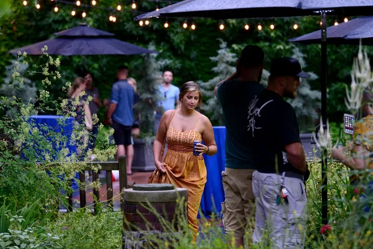 Patrons enjoy cocktails during a pop-up beer garden event at the Mutter Museum early this month.