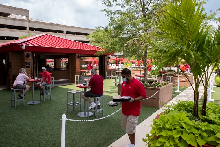 Tables are spread apart at the Borgata Beer Garden at the Borgata Hotel Casino & Spa in Atlantic City, N.J., on Sunday, July 26, 2020. The Borgata Hotel Casino & Spa began welcoming guests again on Sunday, after being closed due to coronavirus restrictions.