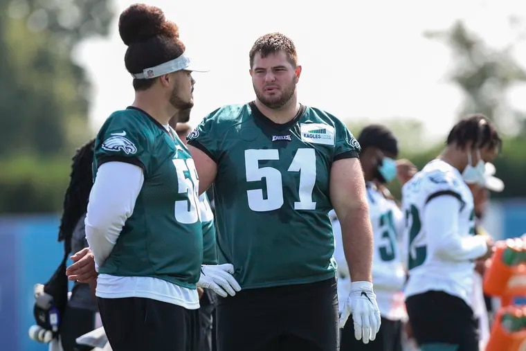 Eagles offensive lineman Landon Dickerson (51) stands on the sideline during the first day of training camp.