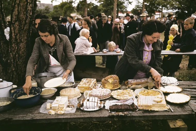 """Russell Lee's photograph, """"Cutting the pies and cakes at the barbeque dinner, Pie Town, New Mexico Fair,""""  at Haverford College's Atrium Gallery"""