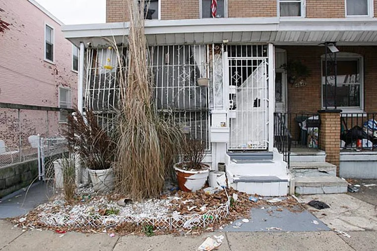 Two dogs and bags of animal bones were removed from this North Front Street home in the city's Feltonville section. (Alejandro A. Alvarez / Staff)
