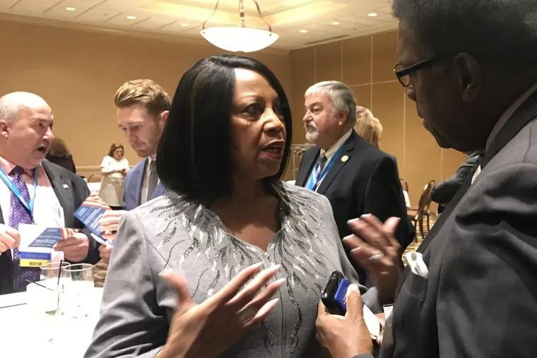 Lt. Gov.-elect Sheila Oliver speaks with Atlantic City Councilman Kaleem Shabazz on Nov. 14 2017 in Atlantic City.