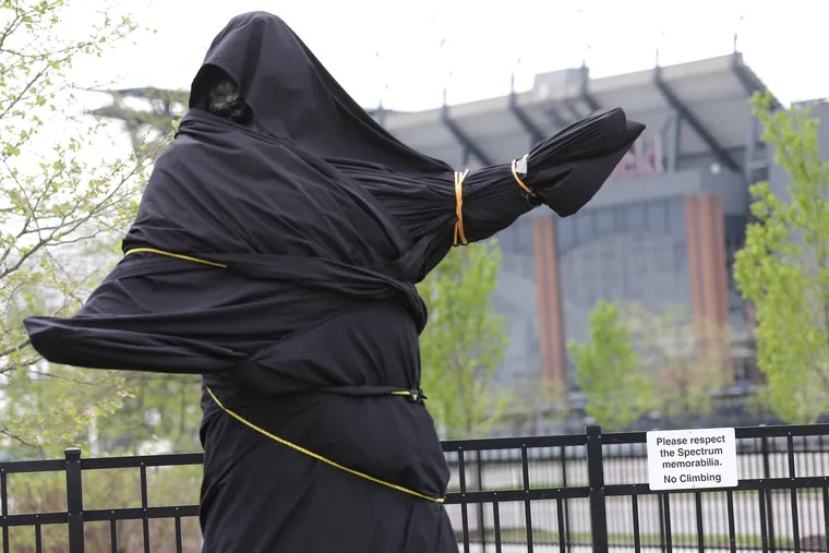 """The covered Kate Smith statue sits outside Wells Fargo Center in Philadelphia, PA on April 19, 2019. The Philadelphia Flyers cut ties with Kate Smith one day after it was revealed the New York Yankees removed her rendition of """"God Bless America"""" due to """"potential racism"""" in past work."""