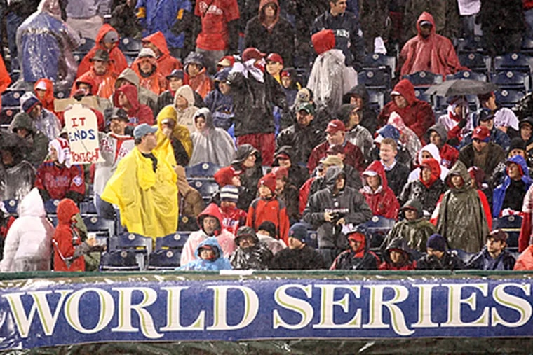Optimistic fans arrived at Citizens Bank Park but left drenched as Game 5 of the World Series was suspended. (Steven M. Falk/Staff Photographer)