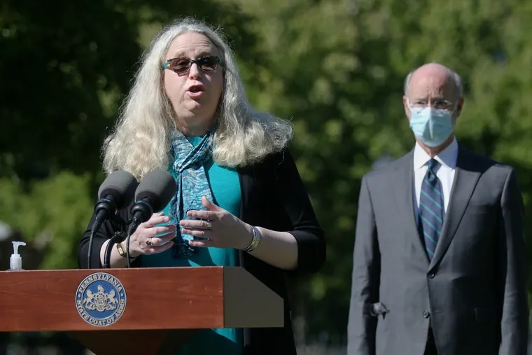 Pennsylvania Secretary of Health Dr. Rachel Levine (left) speaks as Gov. Tom Wolf listens during a news conference about the coronavirus in Philadelphia's Franklin Square in September. Levine recently issued rules under which hospitals will have to reduce the number of elective procedures the do.