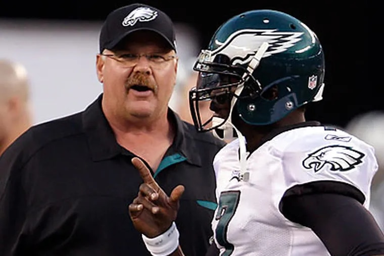 Andy Reid and Michael Vick will, as ever, be key to the Eagles' success in the coming season. (David Maialetti/Staff file photo)