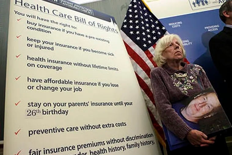 Georgeanne Koehler of Pennsylvania holds a photo of her brother during a health care news conference on Capitol Hill on Monday. (AP Photo / Pablo Martinez Monsivais)