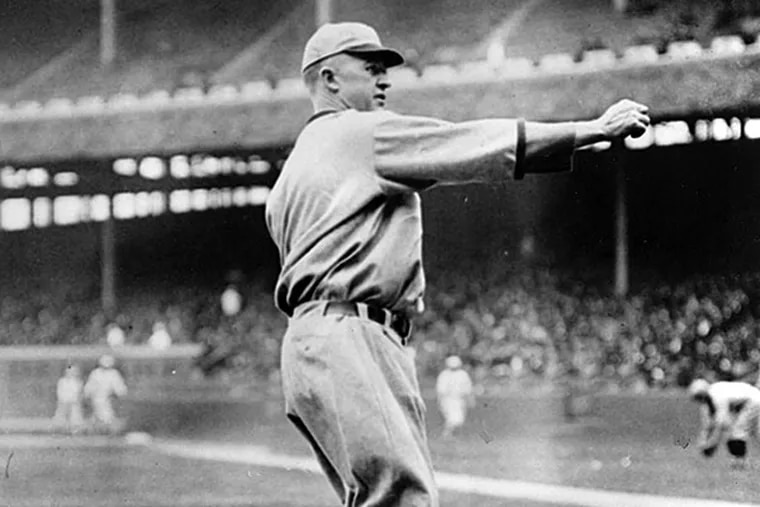 Grover Cleveland Alexander, right-handed pitcher for the St. Louis Cardinals, is shown in action on Sept. 9, 1926 at an unknown location.