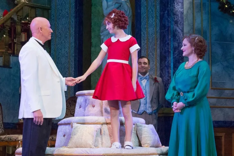"""(Left to right:) Paul Schoeffler, Tahlia Ellie, and Rebecca Robbins in """"Annie,"""" through Jan.   7 at the Walnut Street Theatre."""