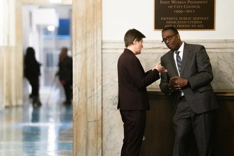Anne Fadullon, director of the department of planning and development, speaks with City Council President Darrell Clark outside a hearing on a bill to change the 10-year tax abatement.
