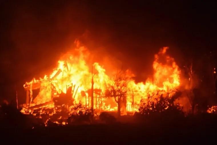 A home burns early Sunday morning off Gobernador Canyon Road in Carpinteria, Calif.
