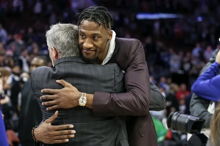 Brett Brown greets former Sixer Robert Covington after the Timberwolves game at the Wells Fargo Center on Jan. 15.