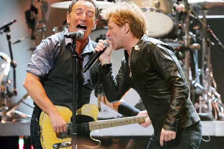 Bruce Springsteen and Jon Bon Jovi perform at the 12-12-12 Hurricane Sandy relief concert at Madison Square Garden in New York. DAVE ALLOCCA / Associated Press