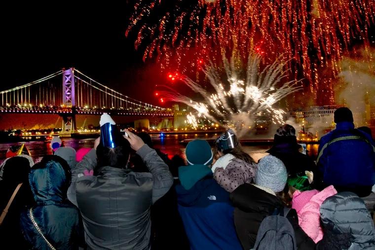 Last year's 6 p.m. fireworks explode over Penn's Landing and the Delaware River.
