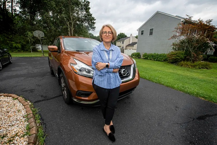 """Romana Gordynsky is pictured near her home in Quakertown, Pa., one Monday, August 23, 2021. She's a member of the """"welcome team"""" who are called upon to meet newcomers at the airport. Many times refugees don't have what's known as a """"US tie,"""" a friend or relative, so Romana goes to meet them - the first American they'll meet in this country."""
