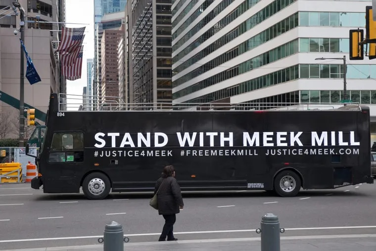 Buses with signs showing support for Meek Mill circled City Hall Tuesday. JESSICA GRIFFIN / Staff Photographer