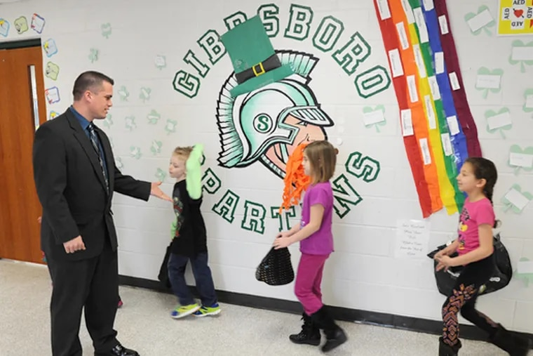 Gibbsboro Elementary School principal Brett Thorp, 35, greets students in the hallway as they head to lunch March 26, 2014. (CLEM MURRAY/Staff Photographer)
