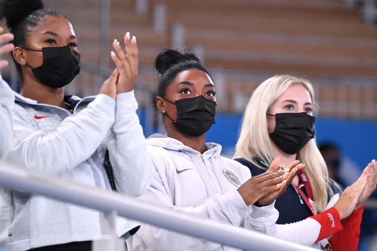 Simone Biles, center, has cheered her teammates on from the stands for the last few days. She'll be back in action on Tuesday.
