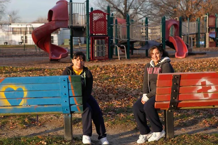 Student leaders Soledad Velazquez (left) and Nelmaris Laureano, both 13 and eighth graders at Saint Anthony of Padua School, are among youths who helped paint benches and clean up garbage at Camden's Von Nieda Park. (Michael S. Wirtz / Staff Photographer)