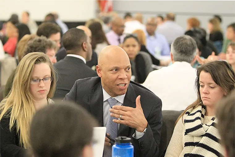 Philadelphia School Superintendent William R. Hite Jr. talks with one of the groups at Monday night's meeting. ( CHARLES FOX / Staff Photographer )