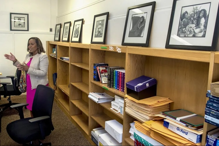 Acting Camden School Superintendent Katrina McCombs iat her office in the new headquarters for the Camden school district. The photos on the shelf are from the old school administration building. They were taken of school children for a calendar for the district.