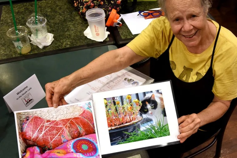 Susan Greenberg shows a photo of her cat, Bella, who died in March at  age  9. She brought the image to the Death Cafe at the Center City Barnes & Noble.