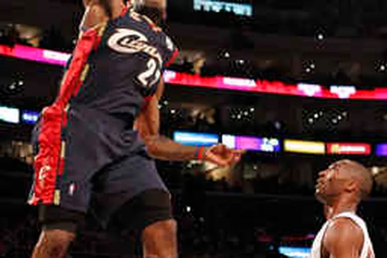 Cleveland's LeBron James dunks over Los Angeles' Kobe Bryant in the first half of the Cavaliers' 102-87 demolition of the Lakers. James finished with 26 points in a contentious game.