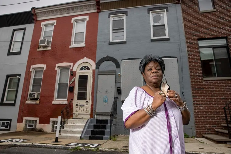Lalla G. Jones at  her home on Ingersoll Street on Tuesday. She lives next to an empty property that, according to her, is flooding her house with cockroaches.