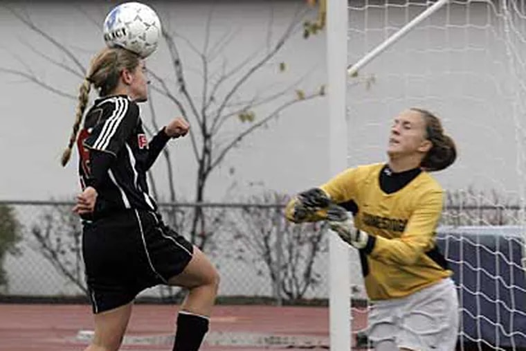 Conestoga goal keeper Meghan Write could not stop Ryan #18 Megan Tole who scores with her heading a ball at 1st half of Archbishop Ryan vs. Conestoga in a Class AAA girls' quarterfinal game. (Akira Suwa / Staff Photographer ).