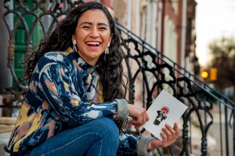 Carmen Aranda with one of her ¡Feliz Mariachi! greeting cards.