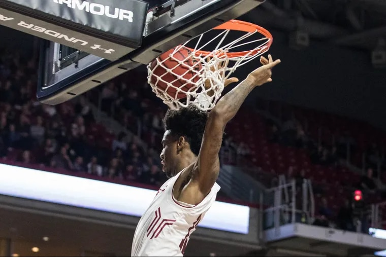 Sophomore Quinton Rose dunking against Central Florida in February.