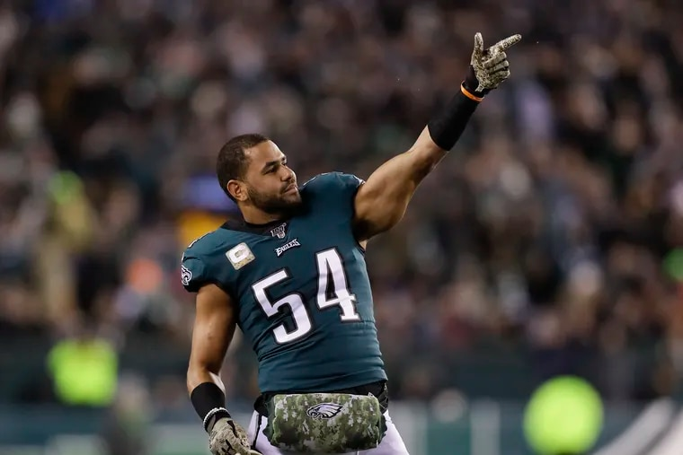 Eagles linebacker Kamu Grugier-Hill points after a video review showed the Eagles scored a second-quarter touchdown against the New England Patriots last month.