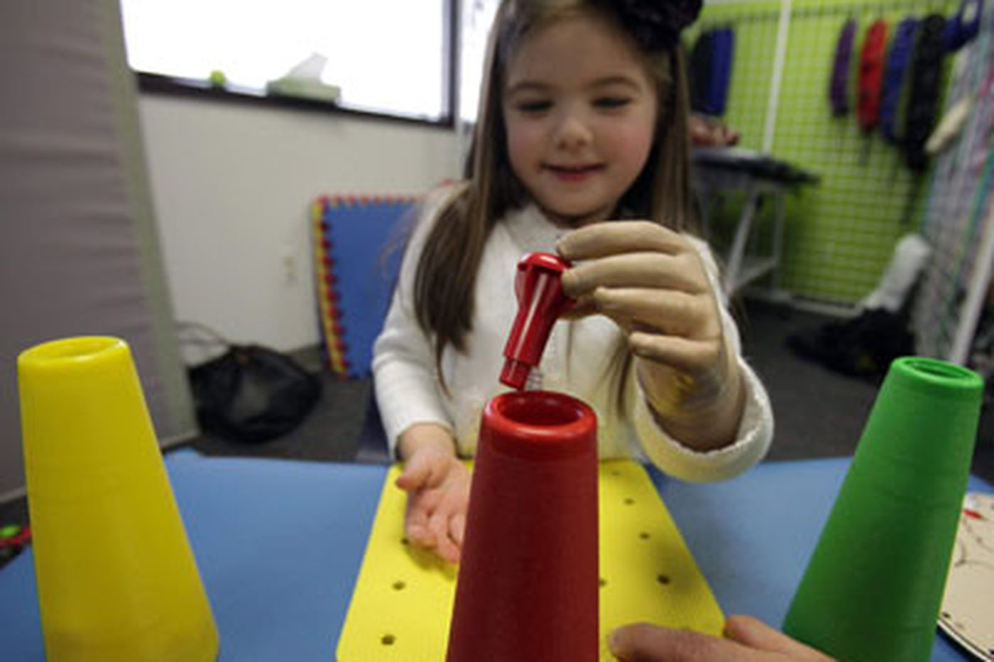Children's lives changed by electronic arm program